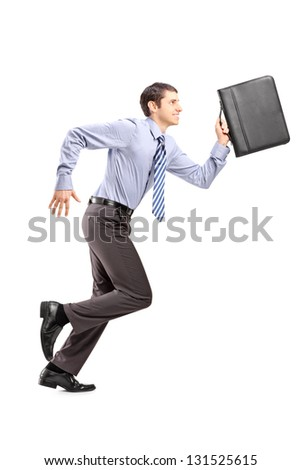 Full length portrait of a businessman running with a briefcase isolated on white background - stock photo