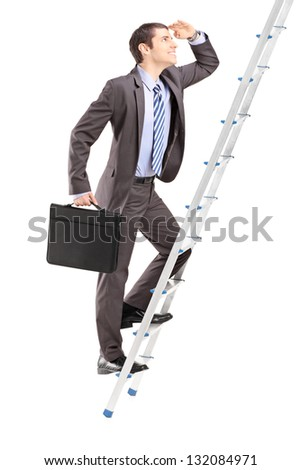 Full length portrait of a businessman with  briefcase climbing a ladder isolated on white background - stock photo
