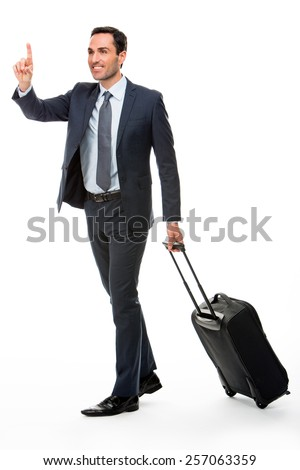 Full length portrait of a businessman with suitcase stopping a taxi - stock photo