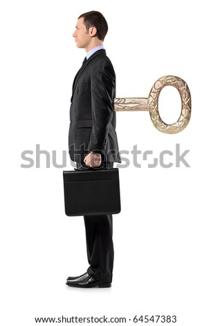 Full length portrait of a businessman with wind-up key in his back isolated against white background - stock photo