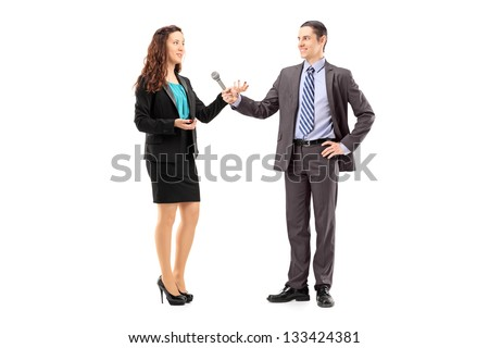 Full length portrait of a businesswoman and male reporter having an interview isolated on white background - stock photo