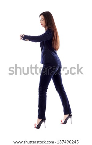 Full length portrait of a businesswoman checking her watch - stock photo