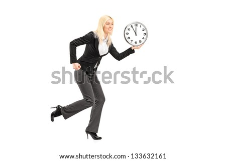 Full length portrait of a businesswoman running with clock isolated on white background - stock photo