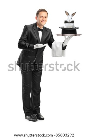 Full length portrait of a butler carrying a tray with a rabbit in a hat on it isolated on white background