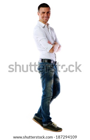 Full length portrait of a casual dressed happy man isolated on white background