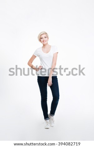 Full length portrait of a casual happy woman standing isolated on a white background - stock photo