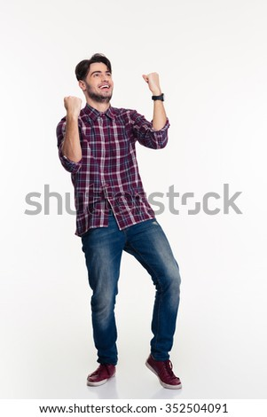 Full length portrait of a casual man celebrating his success isolated on a white background - stock photo