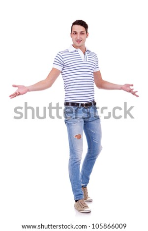 Full length portrait of a casual man gesturing welcome isolated on white background