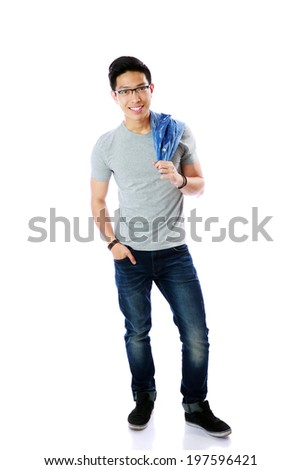 Full length portrait of a casual man standing over white background - stock photo