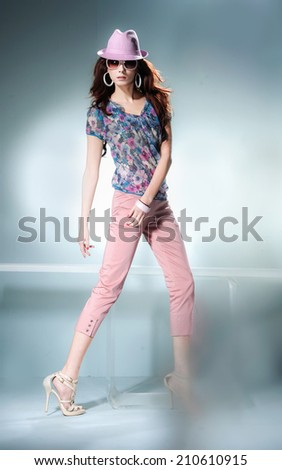 Full length portrait of a casual young fashion in hat posing  - stock photo