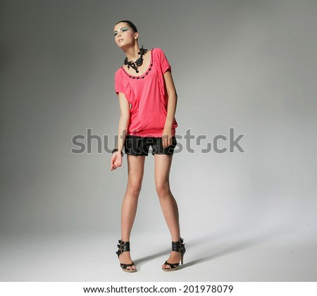 Full length portrait of a casual young fashion model posing