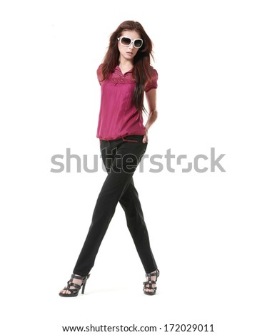 Full length portrait of a casual young fashion model posing on white background  - stock photo