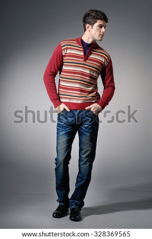 full length Portrait of a casual young in jeans satisfied man  - stock photo