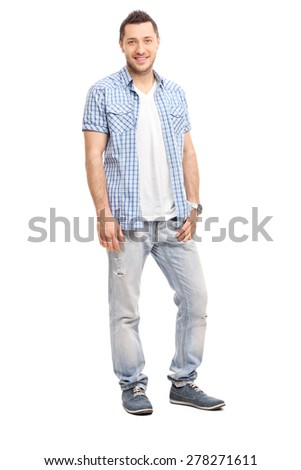 Full length portrait of a casual young man smiling and posing isolated on white background