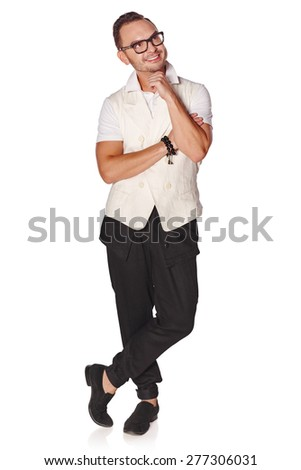 Full length portrait of a casual young pensive man looking up at copyspace, isolated on white background  - stock photo