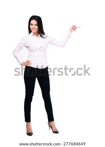 Full length portrait of a cheerful businesswoman pointing finger away. Isolated on a white background. Looking at camera - stock photo