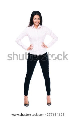 Full length portrait of a cheerful businesswoman standing over white background and looking at camera - stock photo