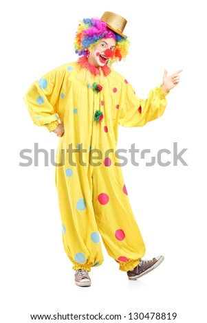 Full length portrait of a cheerful clown in a yellow costume isolated on white background - stock photo