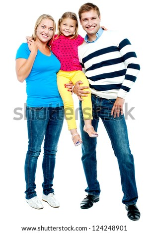 Full length portrait of a cheerful family of three dressed in trendy casuals - stock photo
