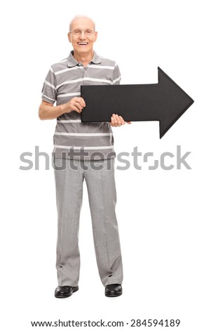 Full length portrait of a cheerful senior gentleman holding an arrow and looking at the camera isolated on white background - stock photo