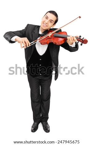 Full length portrait of a cheerful violinist playing a violin isolated on white background - stock photo