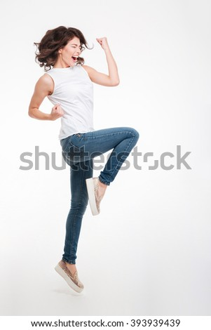 Full length portrait of a cheerful woman celebrating her success isolated on a white background - stock photo