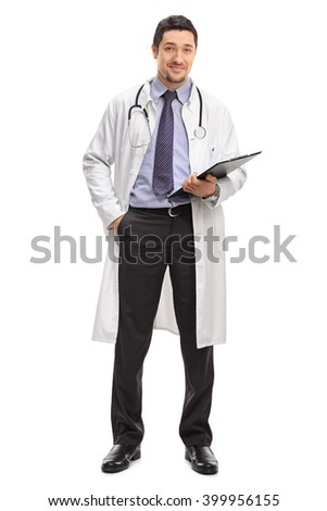 Full length portrait of a cheerful young doctor holding a clipboard and looking at the camera isolated on white background - stock photo