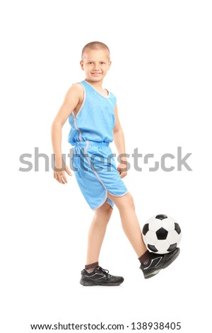 Full length portrait of a child playing with a soccer ball isolated on white background - stock photo