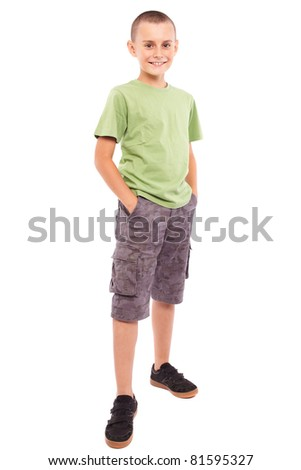 Full length portrait of a child standing, isolated on white background - stock photo