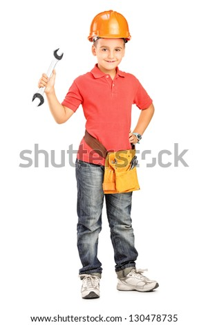 Full length portrait of a child with helmet holding a wrench isolated on white background