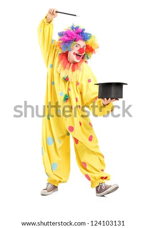 Full length portrait of a circus clown performing a magic trick isolated on white background - stock photo