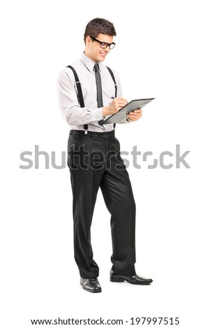 Full length portrait of a classy man writing on a clipboard isolated on white background - stock photo
