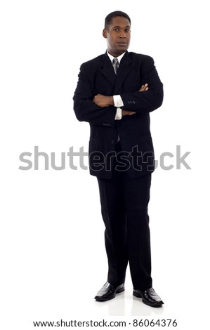 Full length portrait of a confident African American businessman standing with his hands crossed isolated white background - stock photo