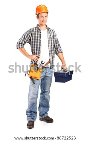 Full length portrait of a confident and smiling manual worker holding a wrench and a toolbox isolated on white background - stock photo