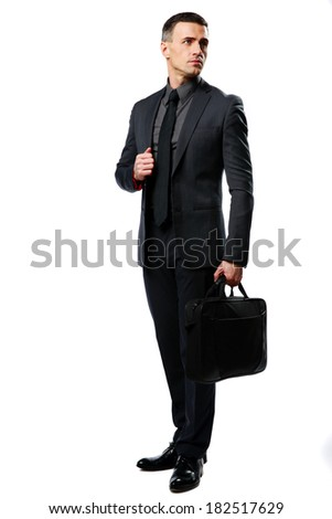 Full-length portrait of a confident businessman with bag isolated on a white background - stock photo