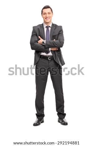 Full length portrait of a confident young businessman in a gray suit looking at the camera isolated on white background - stock photo
