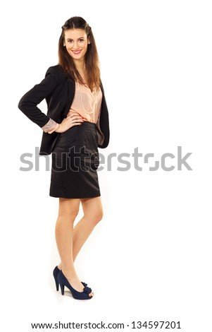 Full length portrait of a confident young businesswoman over white background