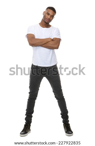 Full length portrait of a confident young man posing with arms crossed on isolated white background - stock photo