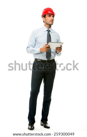 Full length portrait of a construction supervisor with digital tablet looking at a project - stock photo