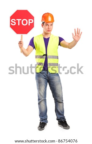 Full length portrait of a construction worker holding a traffic sign stop isolated on white background - stock photo