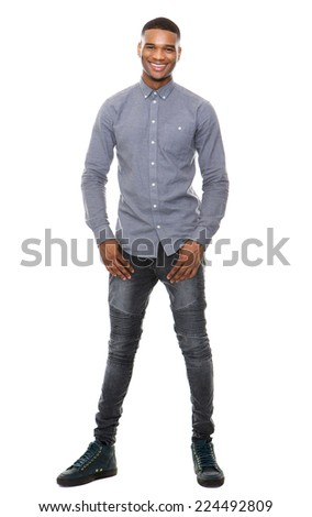 Full length portrait of a cool black guy smiling on isolated white background - stock photo