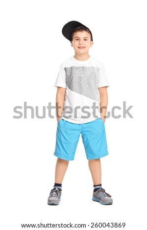 Full length portrait of a cool little boy in trendy clothes isolated on white background - stock photo