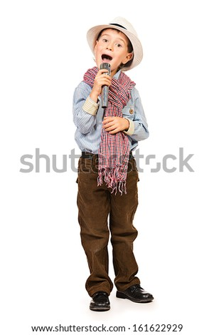 Full length portrait of a cute boy singing with a microphone. Different occupations. Isolated over white. - stock photo