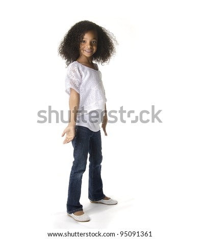 Full length portrait of a cute little African American girl dancing against white background - stock photo