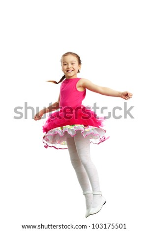 Full length portrait of a cute little girl in jump on white background