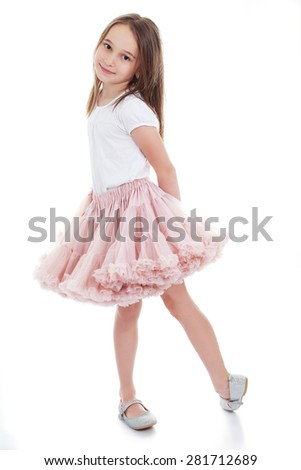 Full length portrait of a cute little girl isolated on white background