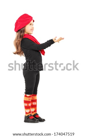 Full length portrait of a cute little girl trying to take something and looking up isolated on white background - stock photo