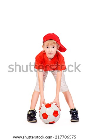 Full length portrait of a cute smiling 7 years old boy with a ball. Isolated over white. - stock photo