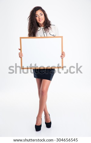 Full length portrait of a cute young businesswoman showing blank board isolated on a white background. Looking at camera - stock photo