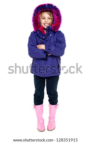 Full length portrait of a cute young girl in winter wear. - stock photo